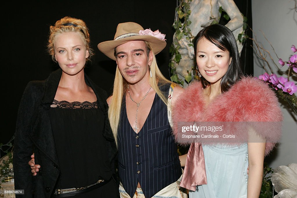 Charlize Theron, Dior designer John Galliano and Zhang Ziyi attend the Christian Dior 2005-2006 'Haute Couture' Fall/Winter fashion collection.