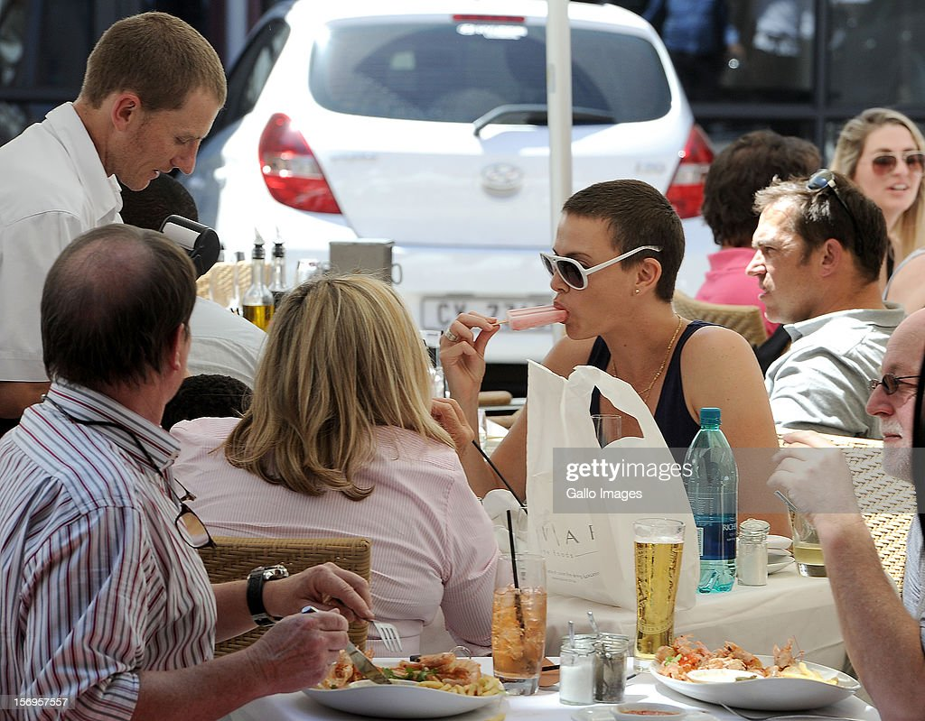 Charlize Theron enjoys an ice-cream while having lunch with her mother Gerda and her adopted son, Jackson, at Beluga at Green Point on November 23, 2012 in Cape Town, South Africa. The actress is in Cape Town to shoot the final scenes for the Australian blockbuster 'Mad Max 4: Fury Road'.