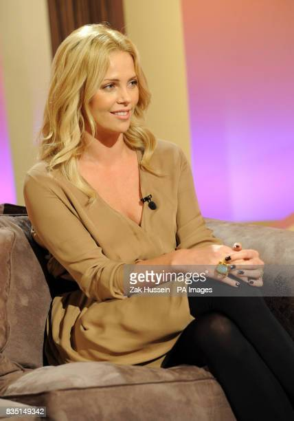 Charlize Theron is interviewed by Richard and Judy for their TV series 'Richard Judy's New Position' at the Cactus TV Studios in Kennington south...