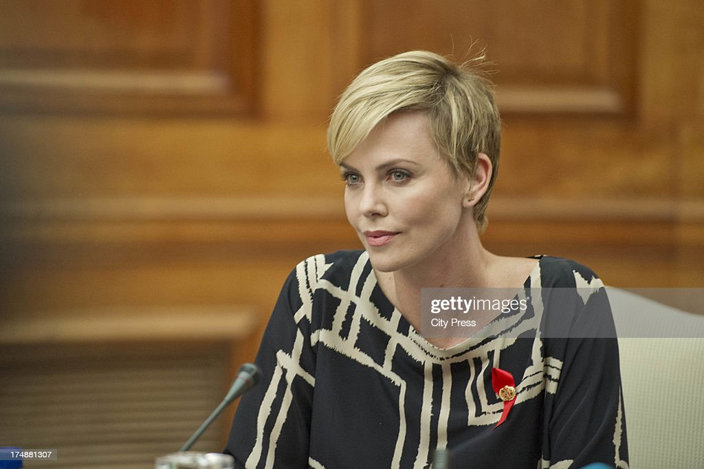 <a gi-track='captionPersonalityLinkClicked' href=/galleries/search?phrase=Charlize+Theron&family=editorial&specificpeople=171250 ng-click='$event.stopPropagation()'>Charlize Theron</a> meets with President Jacob Zuma on July 29, 2013 in Pretoria, South Africa. Theron acting in her capacity as a UN Messenger of Peace discussed the fight against HIV and Aids and how collaboration can assist mitigate the pandemics negative impact on young girls.