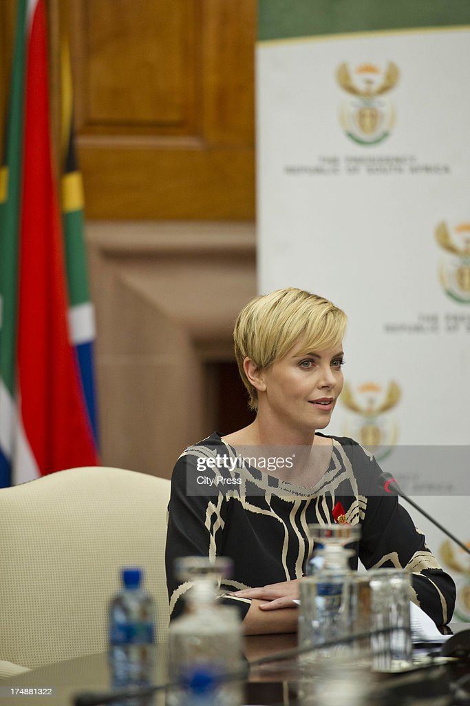 <a gi-track='captionPersonalityLinkClicked' href=/galleries/search?phrase=Charlize+Theron&family=editorial&specificpeople=171250 ng-click='$event.stopPropagation()'>Charlize Theron</a> meets with President <a gi-track='captionPersonalityLinkClicked' href=/galleries/search?phrase=Jacob+Zuma&family=editorial&specificpeople=564982 ng-click='$event.stopPropagation()'>Jacob Zuma</a> on July 29, 2013 in Pretoria, South Africa. Theron acting in her capacity as a UN Messenger of Peace discussed the fight against HIV and Aids and how collaboration can assist mitigate the pandemics negative impact on young girls.