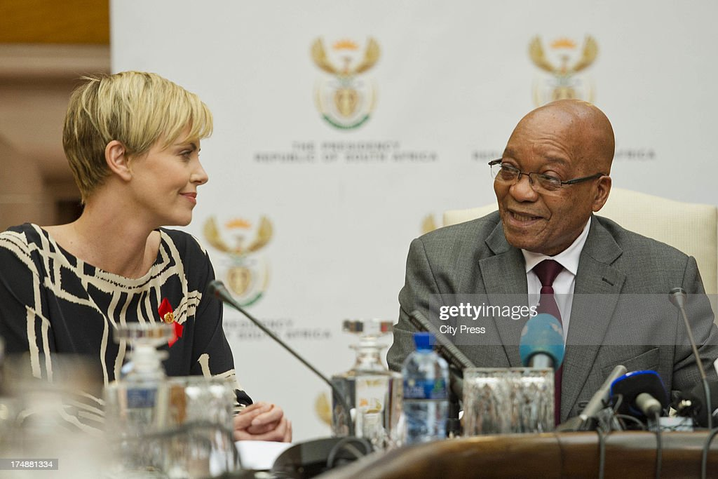 Charlize Theron meets with President Jacob Zuma on July 29, 2013 in Pretoria, South Africa. Theron acting in her capacity as a UN Messenger of Peace discussed the fight against HIV and Aids and how collaboration can assist mitigate the pandemics negative impact on young girls.
