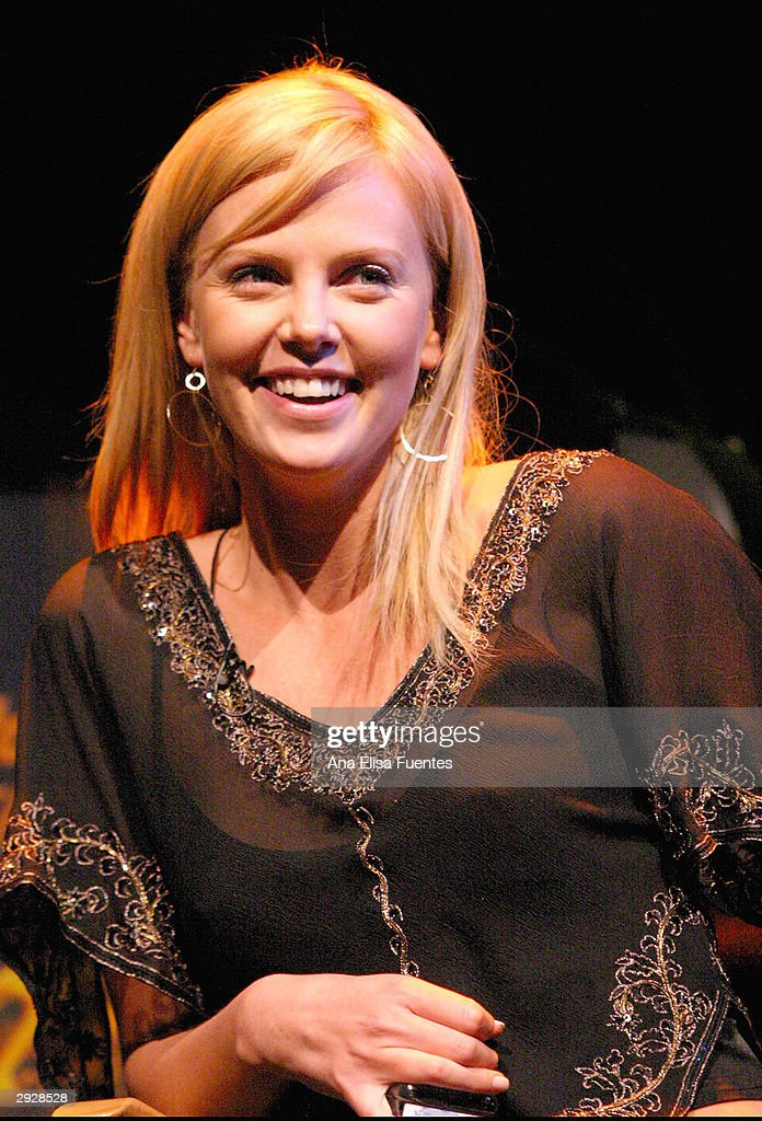 <a gi-track='captionPersonalityLinkClicked' href=/galleries/search?phrase=Charlize+Theron&family=editorial&specificpeople=171250 ng-click='$event.stopPropagation()'>Charlize Theron</a> poses during a tribute to her at the 2004 Santa Barbara International Film Festival on February 3, 2004 in Santa Barbara, California.
