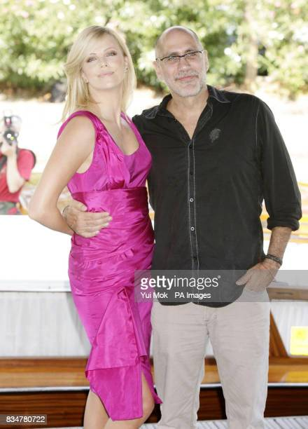 Charlize Theron with the director and writer Guillermo Arriaga arriving by boat for a photocall for the film 'The Burning Plain' at the Palazzo del...