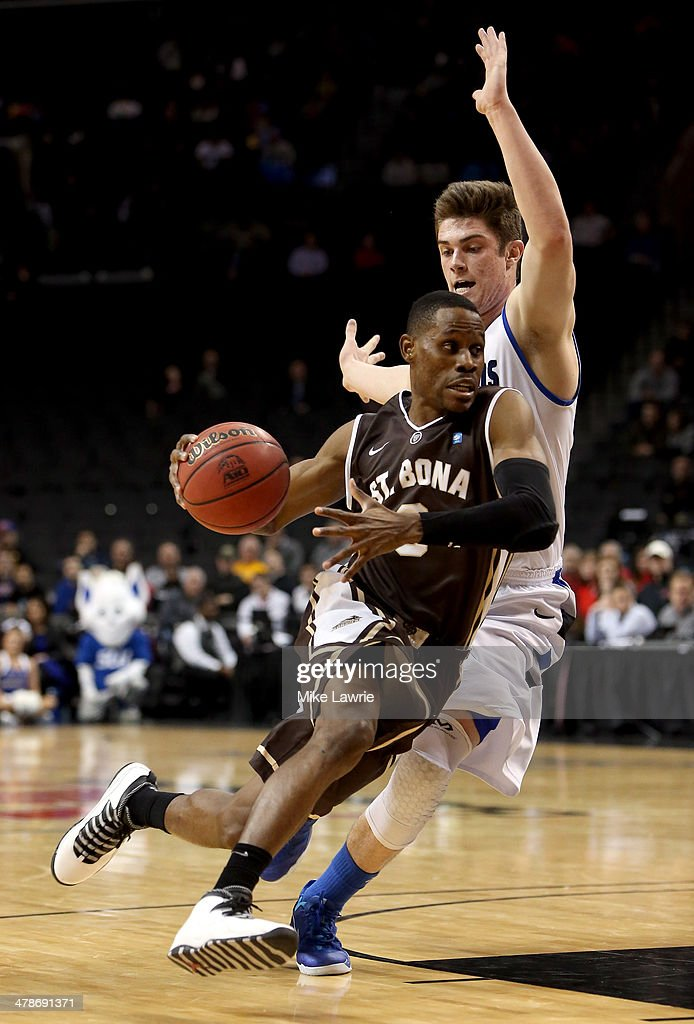 Charlon Kloof of the St Bonaventure Bonnies drives with the ball against Tanner Lancona of the Saint Louis Billikens in the second half during the...