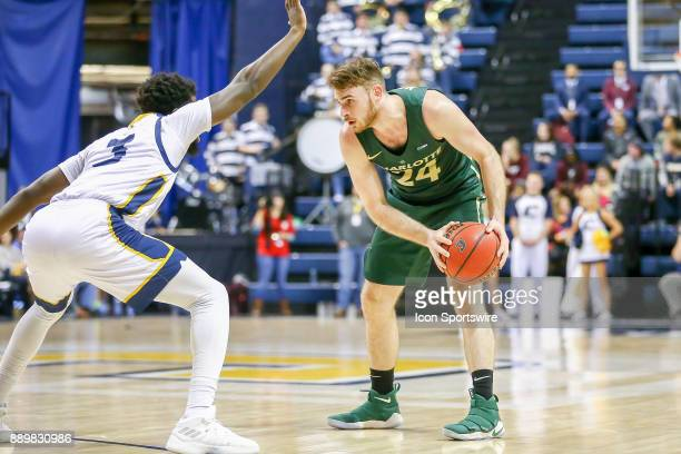 Charlotte 49ers guard Ryan Murphy looks to drives to the basket during the college basketball game between UNC Charlotte and UTChattanooga on...