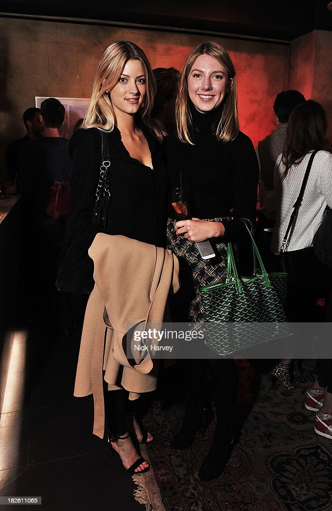 Charlotte Baer and Olivia Paterson attends Baku Cellar 164 for an exclusive show by Gavin Turk, in collaboration with A Space for Art and Baku Magazine in support of The House of Fairytales on October 1, 2013 in London, England.