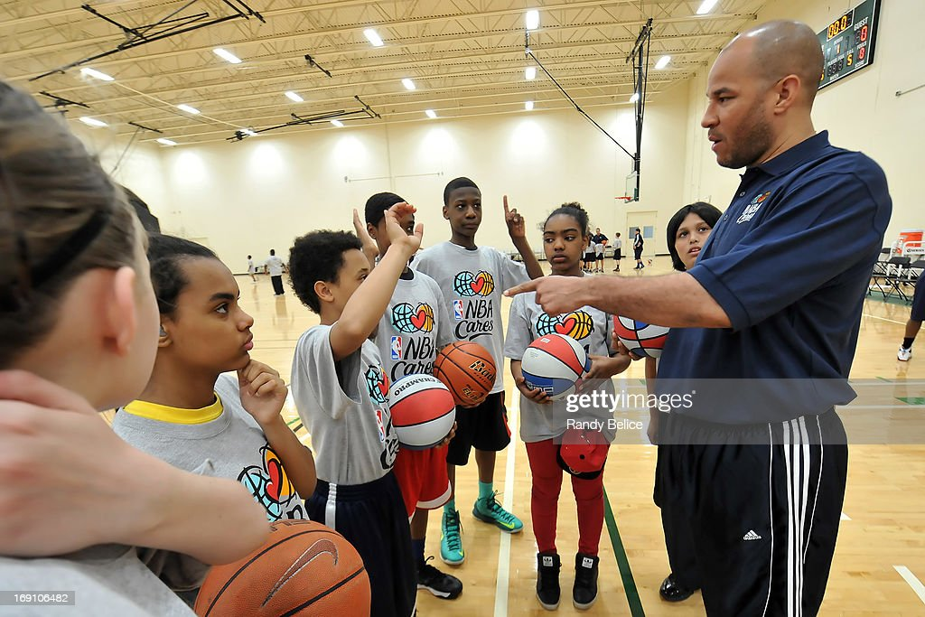 Charlotte Bobcats Assistant Coach Rick Brunson calls upon a participant of a NBA Cares Basketball Clinic as part of the 2013 NBA Draft Combine on May 18, 2013 at Quest Multiplex in Chicago, Illinois.