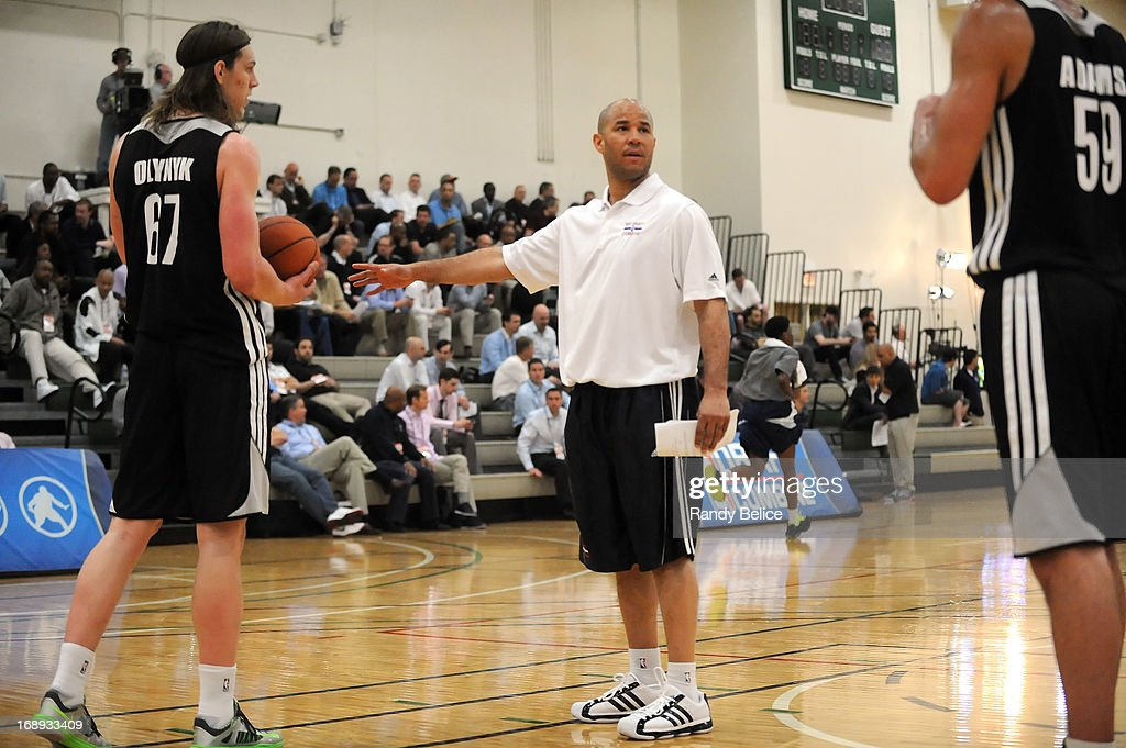 Charlotte Bobcats Assistant Coach Rick Brunson directs Kelly Olynyk #67 and Steven Adams #59 on Day 1 of the 2013 NBA Draft Combine on May 16, 2013 at Quest Multiplex in Chicago, Illinois.