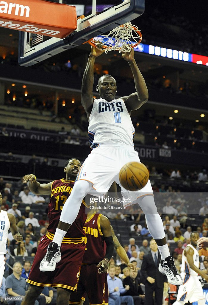 Charlotte Bobcats' Bismack Biyombo (0) dunks past Cleveland Cavaliers' Tristan Thompson (13) during the first half at Time Warner Cable Arena in Charlotte, North Carolina, Wednesday, April 17, 2013.