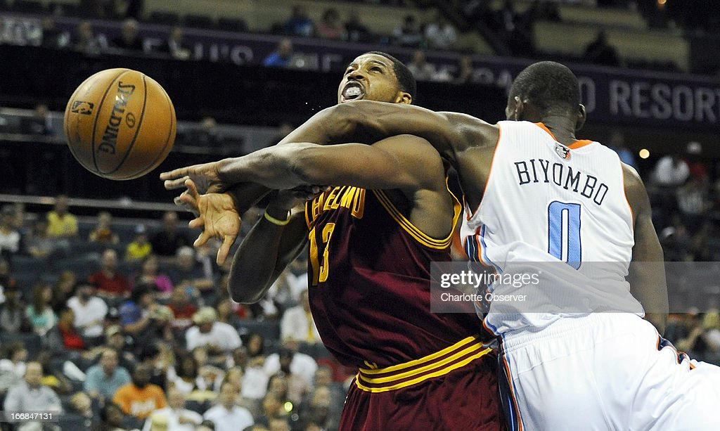 Charlotte Bobcats' Bismack Biyombo (0) fouls Cleveland Cavaliers' Tristan Thompson (13) during the second half at Time Warner Cable Arena in Charlotte, North Carolina, Wednesday, April 17, 2013.