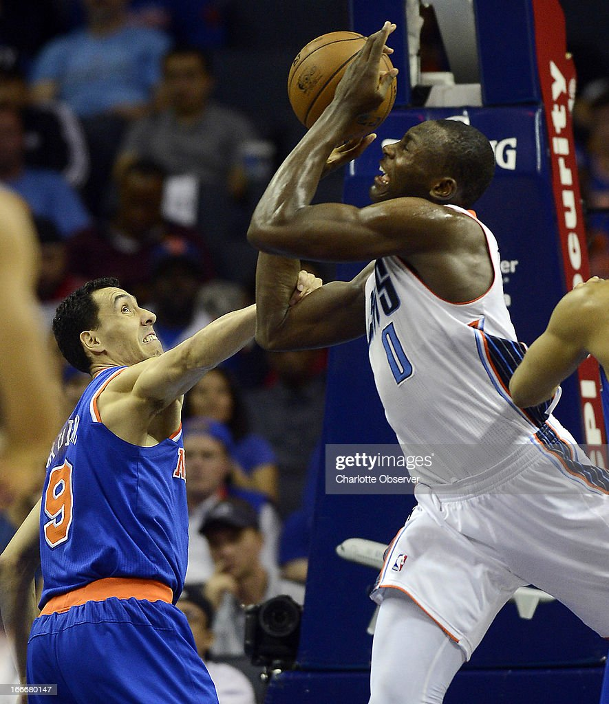 Charlotte Bobcats' Bismack Biyombo (0) is fouled by New York Knicks' Pablo Prigioni (9) during the second half at Time Warner Cable Arena in Charlotte, North Carolina, on Monday, April 15, 2013.