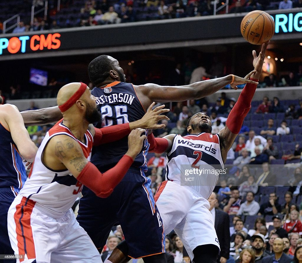 Charlotte Bobcats center Al Jefferson (25) fouls Washington Wizards guard John Wall (2) on a shot attempt during overtime at the Verizon Center in Washington, D.C., Wednesday, April 9, 2014. The Bobcats defeated the Wizards, 94-88.