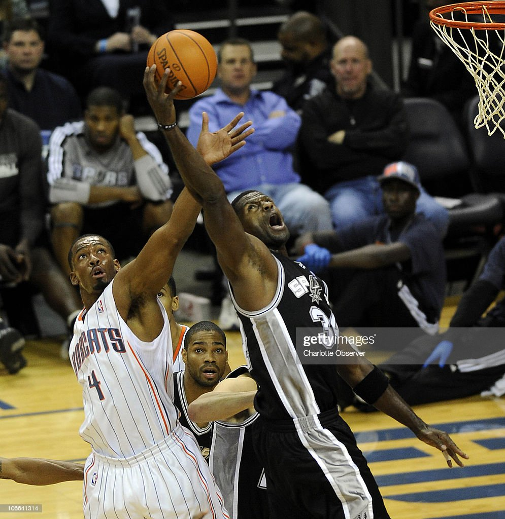 Charlotte Bobcats' Derrick Brown (4) and San Antonio Spurs' Antonio McDyess (34) reach for control of a rebound during the 2nd half at Time Warner Cable Arena in Charlotte, North Carolina, Monday, November 8, 2010. San Antonio won, 95-91.