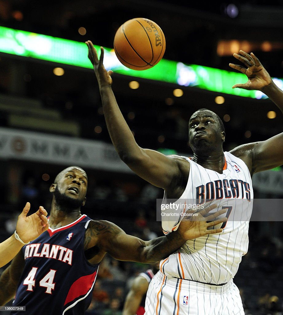 Charlotte Bobcats' DeSagana Diop (7) claims a rebound past Atlanta Hawks' Ivan Johnson (44) during the second half of their preseason game at Time Warner Cable Arena in Charlotte, North Carolina on Monday, December 19, 2011.