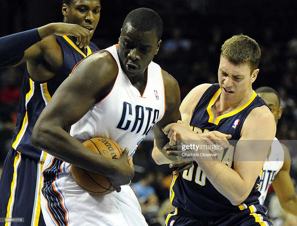 Charlotte Bobcats' DeSagana Diop (2) strips the ball from Indiana Pacers' Tyler Hansbrough (50) in the first half at Time Warner Cable Arena on Wednesday, January 15, 2013, in Charlotte, North Carolina.