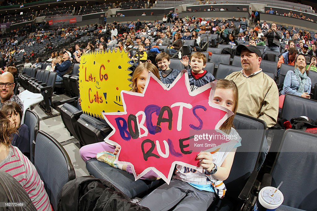 Charlotte Bobcats fans hold up signs during the game against the Minnesota Timberwolves at the Time Warner Cable Arena on January 26, 2013 in Charlotte, North Carolina.