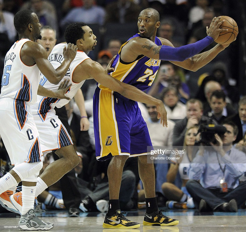 Charlotte Bobcats guard Kemba Walker (15) and guard Gerald Henderson (9) apply defensive pressure on Los Angeles Lakers guard Kobe Bryant (24) during first-half action at Time Warner Cable Arena in Charlotte, North Carolina, Friday, February 8, 2013. The Lakers defeated the Bobcats 100-93.