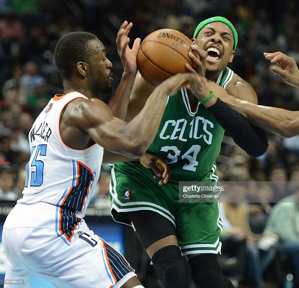 Charlotte Bobcats guard Kemba Walker applies defensive pressure against Boston Celtics forward Paul Pierce during second-half action at Time Warner Cable Arena in Charlotte, North Carolina, Monday, February 11, 2013. The Bobcats defeated the Celtics 94-91.