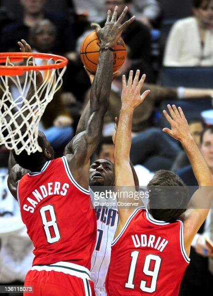 Charlotte Bobcats guard Kemba Walker has his shot blocked by the Milwaukee Bucks' Larry Sanders on a drive to the basket as Bucks teammate Beno Udrih...