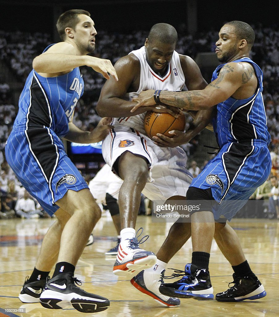 Charlotte Bobcats guard Raymond Felton (20) gets tied up between Orlando Magic defenders Ryan Anderson (33) and Jameer Nelson (14) in Game 3 of the NBA Eastern Conference playoffs at Time Warner Cable Arena in Charlotte, North Carolina, Saturday, April 24, 2010. The Magic won, 90-86.