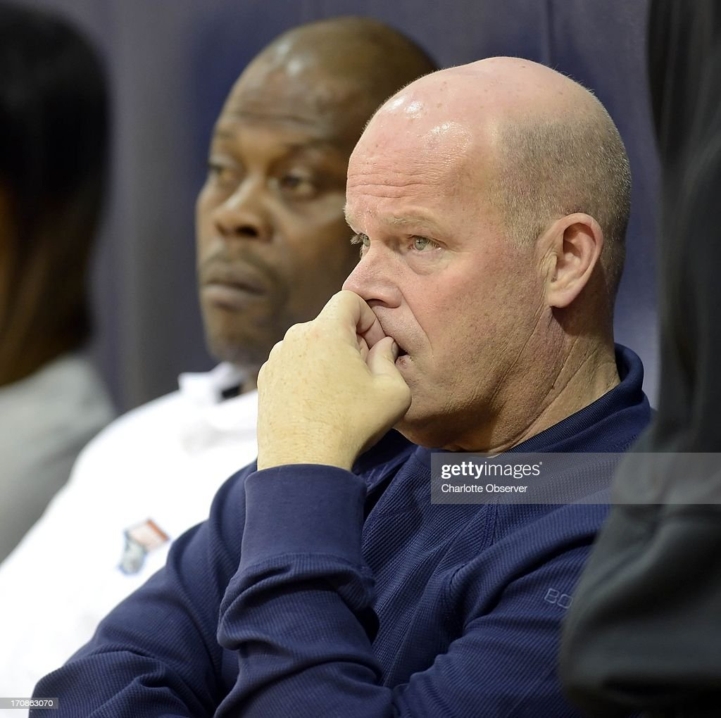 Charlotte Bobcats head coach Steve Clifford, right, and assistant head coach Patrick Ewing watch a team pre-draft workout, Wednesday, June 19, 2013, in Charlotte, North Carolina.