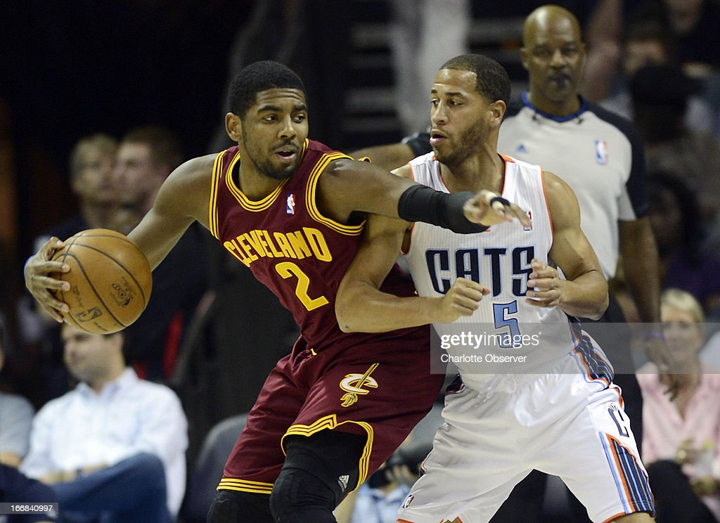 Charlotte Bobcats' Jannero Pargo (5) guards Cleveland Cavaliers' Kyrie Irving (2) during the first half at Time Warner Cable Arena in Charlotte, North Carolina, Wednesday, April 17, 2013.