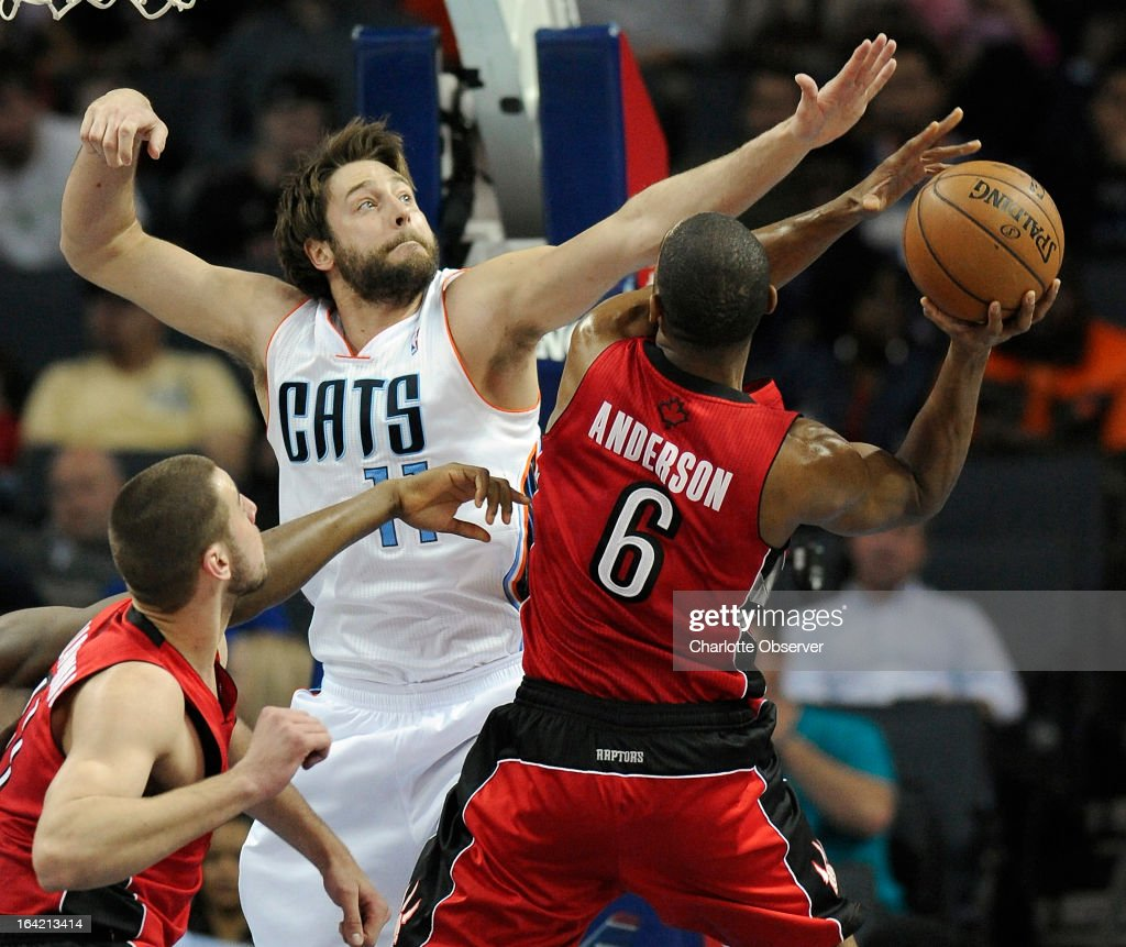 Charlotte Bobcats Josh McRoberts tries to block a shot by Toronto Raptors Alan Anderson during first-quarter action at Time Warner Cable Arena in Charlotte, North Carolina, on Wednesday, March 20, 2013. Charlotte won, 107-101.