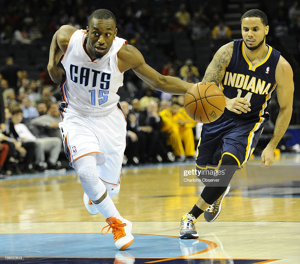 Charlotte Bobcats' Kemba Walker (15) looks for an angle to the basket as Indiana Pacers' D.J. Augustin (14) defends during the second half at Time Warner Cable Arena on Wednesday, January 15, 2013, in Charlotte, North Carolina. The Pacers won 103-76.
