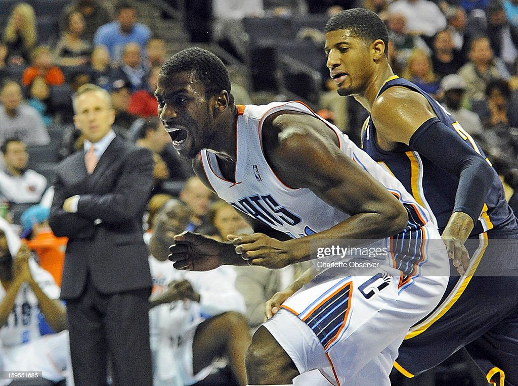 Charlotte Bobcats' Michael Kidd-Gilchrist (14) screams after losing control of a loose ball as Indiana Pacers' Paul George (24) defends in the first half at Time Warner Cable Arena on Wednesday, January 15, 2013, in Charlotte, North Carolina.