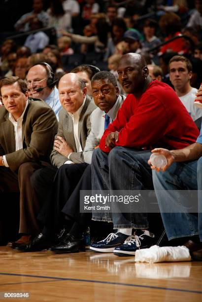 Charlotte Bobcats Owner Bob Johnson and Managing Member of Basketball Operations Michael Jordan watch the Bobcats game against the Philadelphia 76ers...
