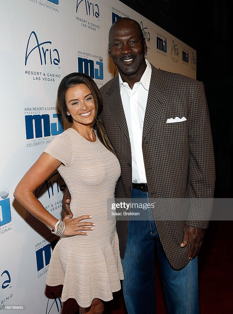 Charlotte Bobcats owner Michael Jordan (R) and fiancee Yvette Prieto arrive at the 12th Annual Michael Jordan Celebrity Invitational Gala At ARIA Resort & Casino on April 5, 2013 in Las Vegas, Nevada.