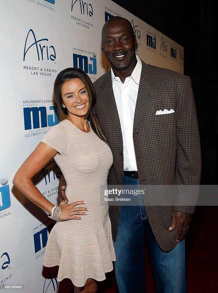 Charlotte Bobcats owner Michael Jordan (R) and fiancee Yvette Prieto arrive at the 12th Annual Michael Jordan Celebrity Invitational Gala At ARIA Resort & Casino on April 5, 2013 in Las Vegas, Nevada.
