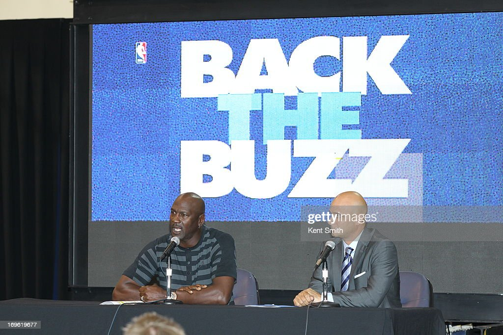 Charlotte Bobcats owner Michael Jordan and Pete Guelli, Executive Vice President and Chief Sales and Marketing Officer announce the team name change to the Charlotte Hornets at the Time Warner Cable Arena on May 21, 2013 in Charlotte, North Carolina.