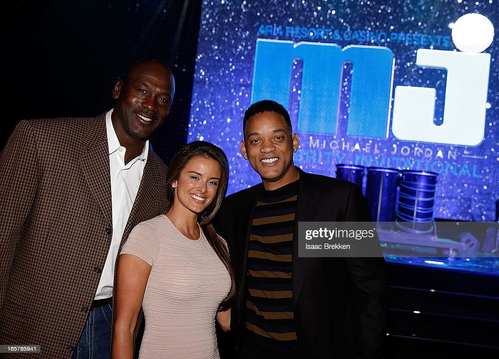Charlotte Bobcats owner Michael Jordan (L) fiancee Yvette Prieto and actor Will Smith (R) attend the 12th Annual Michael Jordan Celebrity Invitational Gala At ARIA Resort & Casino on April 5, 2013 in Las Vegas, Nevada.