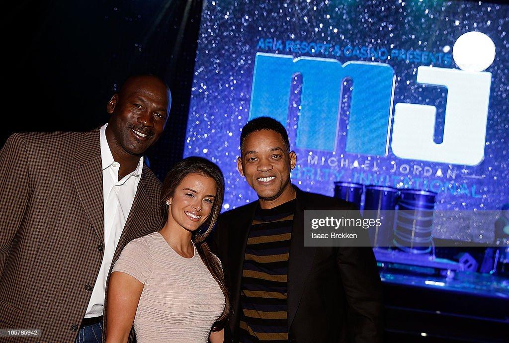 Charlotte Bobcats owner Michael Jordan (L) fiancee Yvette Prieto and actor Will Smith (R) attend the 12th Annual Michael Jordan Celebrity Invitational Gala At ARIA Resort & Casino on April 5, 2013 in Las Vegas, Nevada.