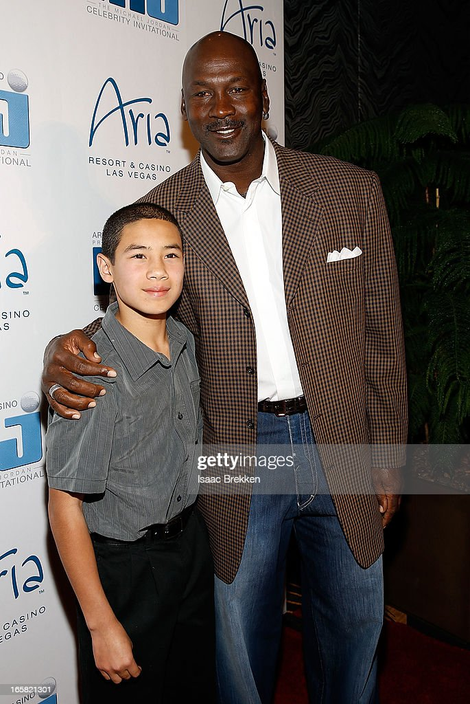 Charlotte Bobcats owner Michael Jordan (R) greets Make-A-Wish Kid Joseph Dominguez at the 12th Annual Michael Jordan Celebrity Invitational Gala At ARIA Resort & Casino on April 5, 2013 in Las Vegas, Nevada.