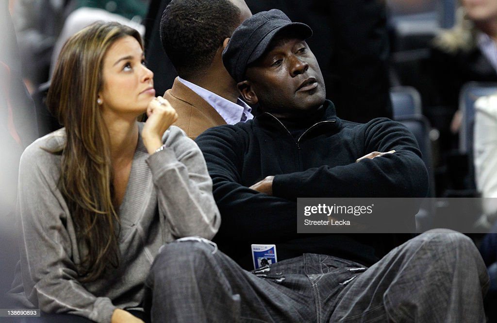 Charlotte Bobcats owner, <a gi-track='captionPersonalityLinkClicked' href=/galleries/search?phrase=Michael+Jordan+-+Basketball+Player&family=editorial&specificpeople=73625 ng-click='$event.stopPropagation()'>Michael Jordan</a> sits beside fiance, Yvette Prieto during the game between the Chicago Bulls and the Charlotte Bobcats at Time Warner Cable Arena on February 10, 2012 in Charlotte, North Carolina.