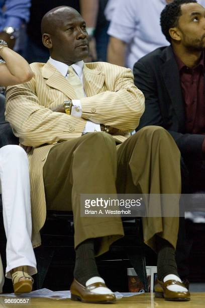Charlotte Bobcats principal owner Michael Jordan watches the action against the Orlando Magic in Game Four of the Eastern Conference Quarterfinals...