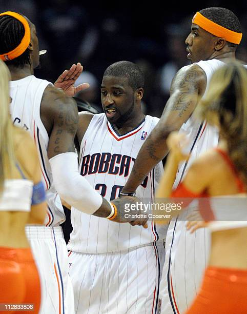 Charlotte Bobcats' Raymond Felton congratulates teammates Gerald Wallace and Tyrus Thomas after coming from behind to defeat the Miami Heat at the...
