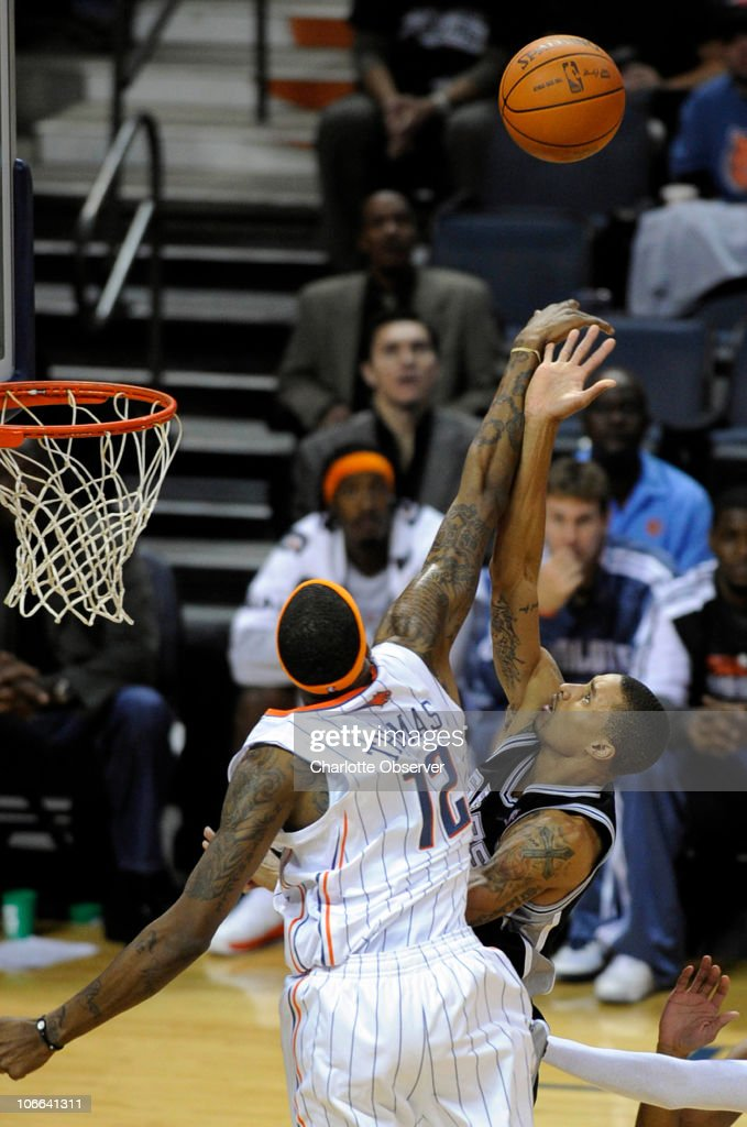Charlotte Bobcats' Tyrus Thomas (12) blocks the shot of San Antonio Spurs' George Hill (3) during the 2nd half at Time Warner Cable Arena in Charlotte, North Carolina, Monday, November 8, 2010. San Antonio won, 95-91.