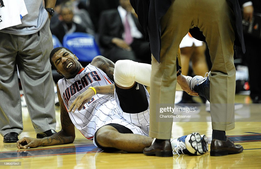 Charlotte Bobcats' Tyrus Thomas (12) grimaces as his ankle is looked at after being injured in the second half against the Atlanta Hawks during their preseason game at Time Warner Cable Arena in Charlotte, North Carolina on Monday, December 19, 2011.