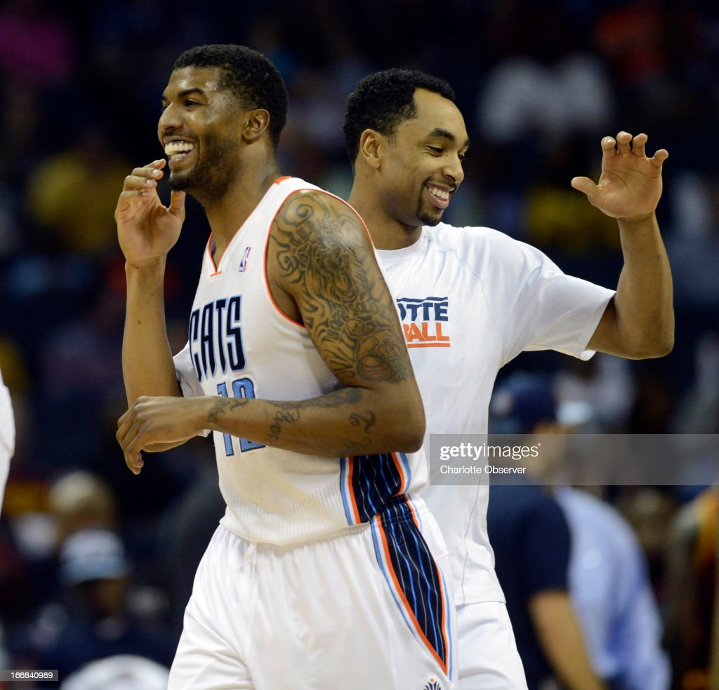 Charlotte Bobcats' Tyrus Thomas (12) is congratulated by teammate Gerald Henderson (9) during a first-half timeout in an NBA game against the Cleveland Cavaliers at Time Warner Cable Arena in Charlotte, North Carolina, Wednesday, April 17, 2013.