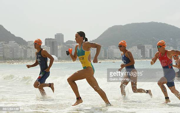 Charlotte Bonin of Italy Emma Moffatt of Australia Yuka Sato of Japan and Flora Duffy of Bermuda leave the water during the Women's Triathlon on Day...