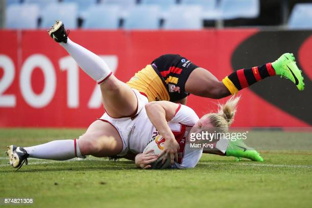 Charlotte Booth of England scores a try during the 2017 Women's Rugby League World Cup match between England and Papua New Guinea at Southern Cross...
