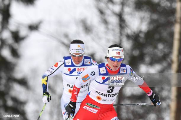 Charlotte Calla from Sweden behind Marit Bjoergen from Norway during Ladies crosscountry 30 km Mass Start Free final at FIS Nordic World Ski...