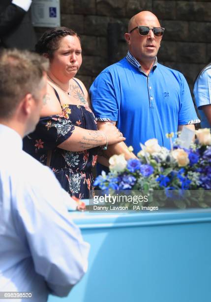 Charlotte Campbell and Paul Hodgson the mother and stepfather of Olivia CampbellHardy look on as her coffin arrives for the funeral service of the...