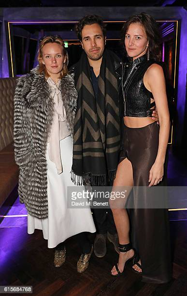 Charlotte Carroll Diego BiveroVolpe and guest attend the launch of MNKY HSE latenight restaurant Mayfair on October 19 2016 in London England