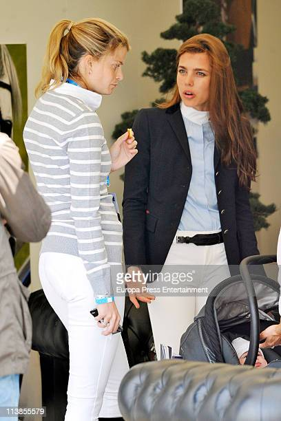 Charlotte Casiraghi and Athina Onassis talk to aech other during the Global Champions Tour 2011 on May 8 2011 in Valencia Spain