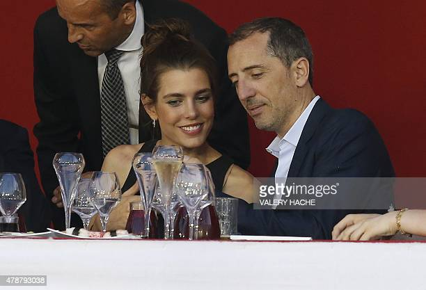 Charlotte Casiraghi and French humorist and actor Gad Elmaleh attend at the 2015 edition of the Jumping International of Monaco horse jumping...